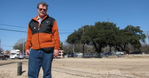 "Michael Fossum of the Austin Heritage Tree Foundation stands in front of the heritage Live Oak known as the ""Taco Bell Tree."" Fossum and his group fought to save the tree from being cut down for a traffic project. Now it's going to be moved across the street."