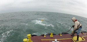 A&M's buoy hits the water and begins sending back data on wind, currents, and waves