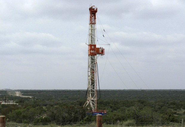 A rig contracted by Apache Corp drills a horizontal well in a search for oil and natural gas in the Wolfcamp shale located in the Permian Basin in West Texas. A successful petition in Denton could bring fracking bans to communities around the state.