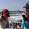 US Coast Guard Lt. Dave Wood with volunteers on Galveston Island