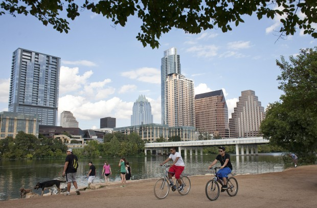 Cyclists pass beneath the downtown skyline on the hike and bike trail on Lady Bird Lake in Austin, Texas September 18, 2012. While traditionally an aesthetic pleasure, the lake could be used to help treat water.