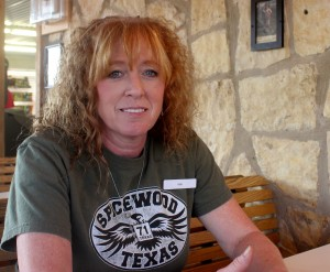Kim Clifton, a cashier, says her business has managed to keep busy as the only general store in Spicewood Beach. Other businesses can't stay afloat in this small, tourist driven economy.