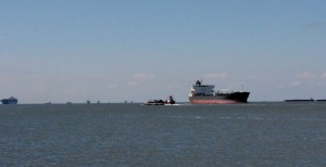 Big freighters and small barges in the Houston Ship Channel near the site of the collision.