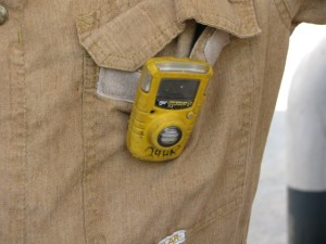 Oil field workers wear these safety alert devices that detect hydrogen sulfide gas