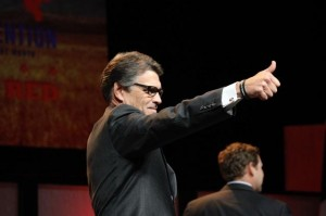 RIck Perry gives GOP delegates at the state convention a thumbs up in June 2014.