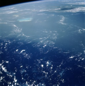 This image, taken by astronauts in the International Space Station from 160 above Earth, shows a Saharan dust cloud (in the frame's top half) floating across the Caribbean. The camera is pointed southwest and the land in the upper right is Haiti.
