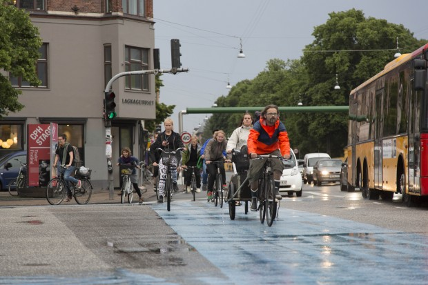 Cyclist commuting in the Copenhagen neighborhood of Norrebro.