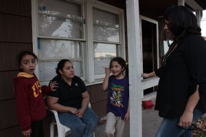 Esmerelda Moreno and her two daughters talk with Belinda Vasquez.