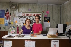 Penny Gordon and Bonnie Whitley work at the Food Pantry.