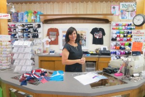 """Lidia Escobar says business in her store has dropped off. """"It's like a ghost town,"""" she says."""