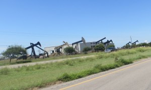 Pump jacks line the road into Alice, Texas.