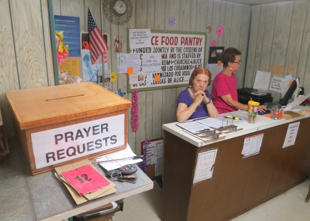 A box at the Alice Food Pantry accepts prayer requests. Many people in Alice have lost jobs since the prices of oil dropped.